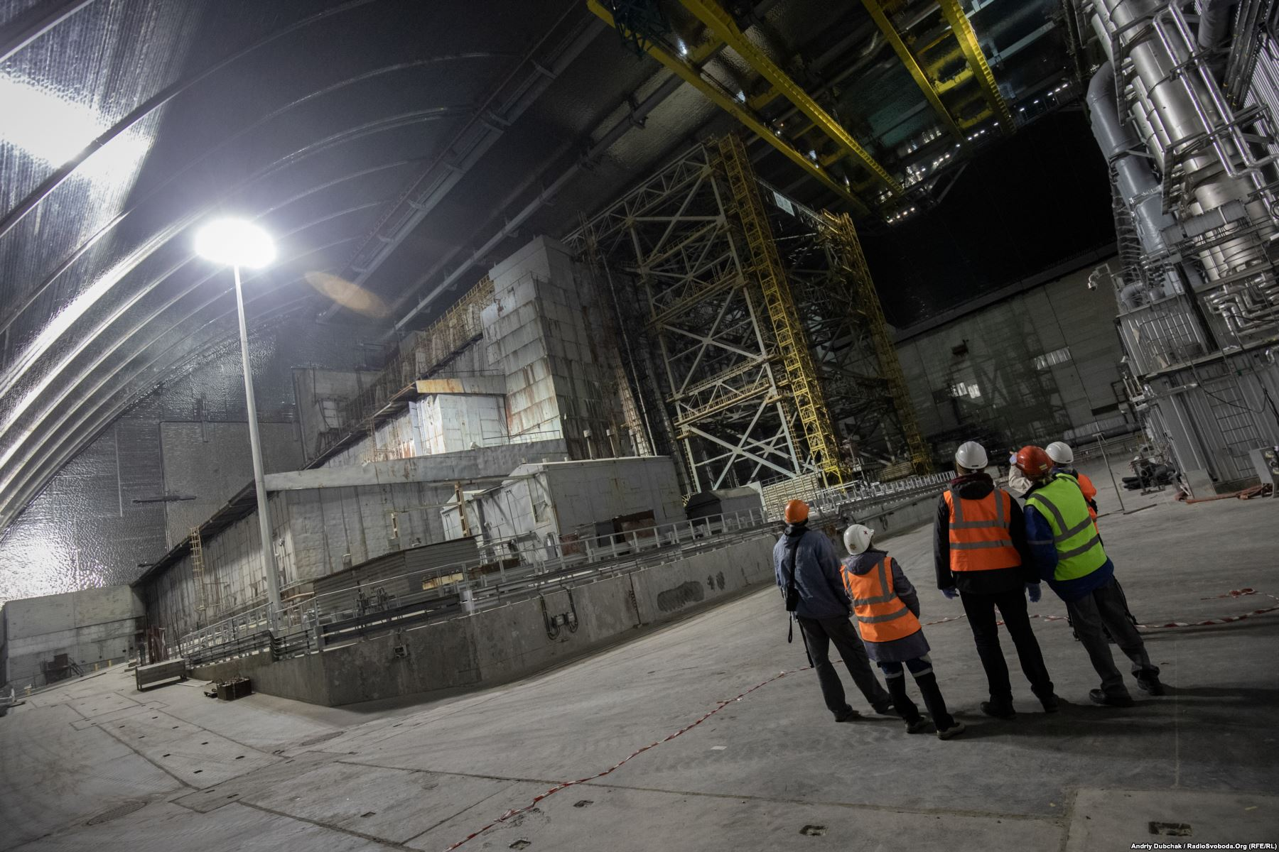 The old concrete sarcophagus under the New Safe Confinement (NSC). There remains an estimated 200 tons of radioactive fuel inside the crippled reactor. Photo by: Andriy Dubchak