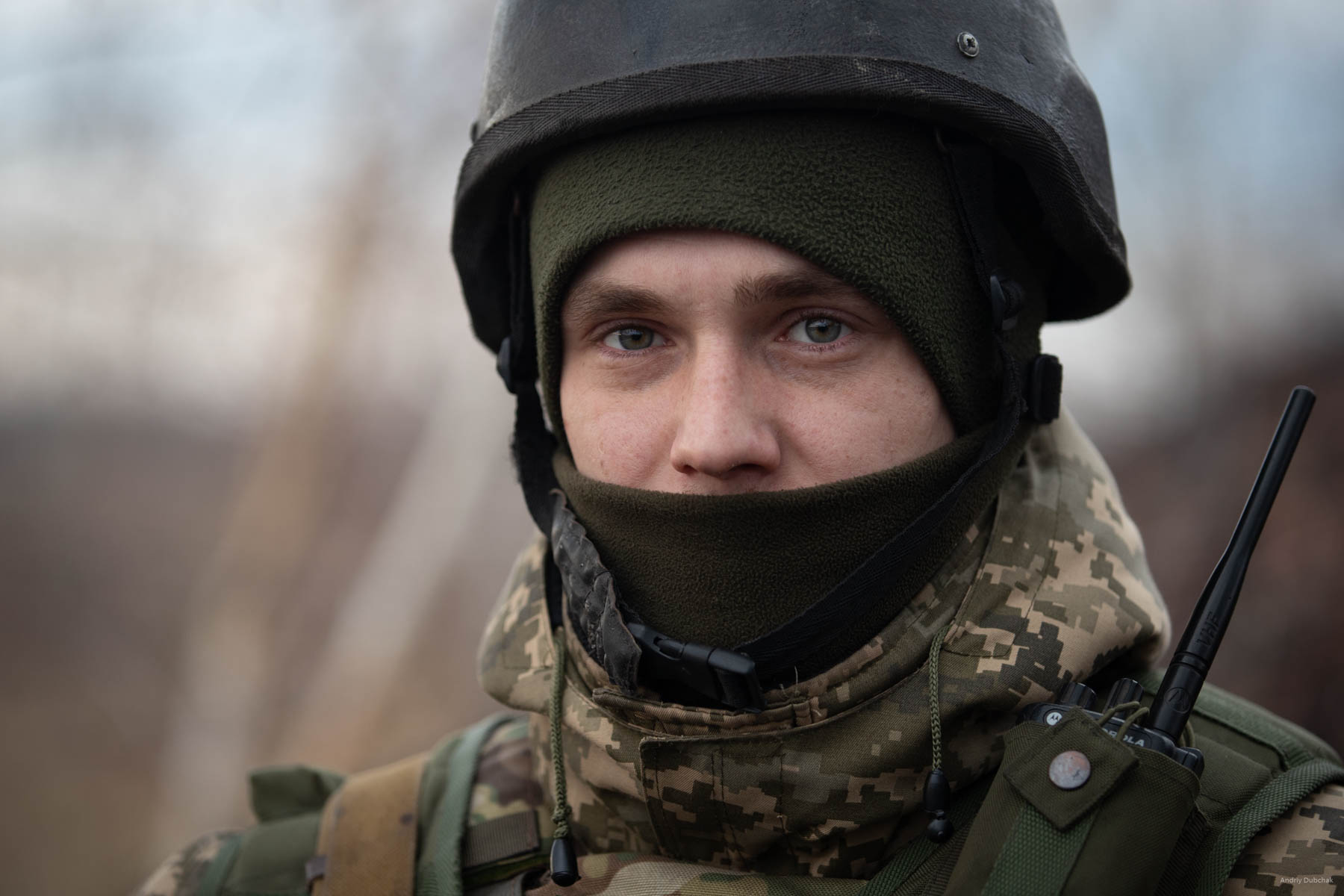 Alexander is 28 years old. Originally, from Chernigov region, he speaks calmly, confidently, logically. He is in the war since 2014, started fighting with the first wave of mobilization. Three months later, he was discharged for some reason. In 2015, he was called up for military service again with the sixth wave of mobilization. He served 15 months mobilization duty, and then remained for a half-year contract.  After that he returned home for six months, could not stand it and signed the contract. In a matter of a split second after this photo shot, we were shot at by an enemy sniper.  (Video of this moment: https://goo.gl/pBeMHU) It was a narrow escape, but a week later, a sniper tapped the boy in the head. 7.62 bullet came under the helmet - the brain was injured. Now, he is slowly recovers and undergoes a long rehab in Lviv. District of Popasnoy, December 2017