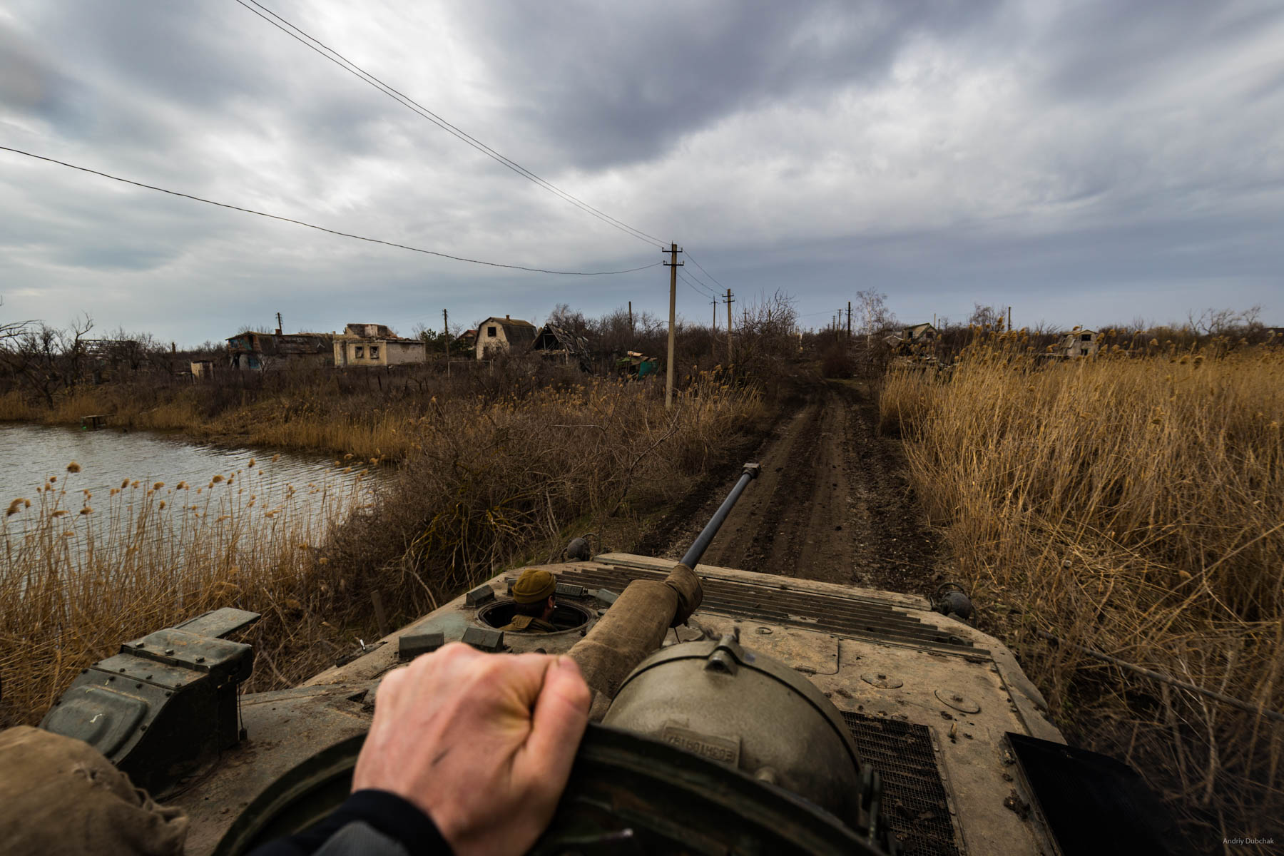 """Mounted on the armor of BMP-2 navigating Vodyane Since the beginning of the conflict, the village was mostly under the control of militants of Russian hybrid forces, although, according to the Minsk agreements, Vodyane ought to be controlled by Ukrainian side. Only in early 2017, militants were completely expelled. All valuables were looted then, and now most of the """"insides"""" of buildings are just heaps of burnt debris. The village was often hit by artillery of various calibers and """"Hradamy""""(missile artillery). Even now, sometimes, somewhere """"Stodvadtsyatka"""" (120-millimeter mine) can arrive. Most of the front positions of the marines are located a few hundred meters away from the village. All needed is brought down - firewood, water, food, ammunition. The enemy, as a rule, can shoot through the roads here. Where possible armored vehicles deliver goods, where not - everything has to be brought by hand. Video: https://goo.gl/naFV2E"""