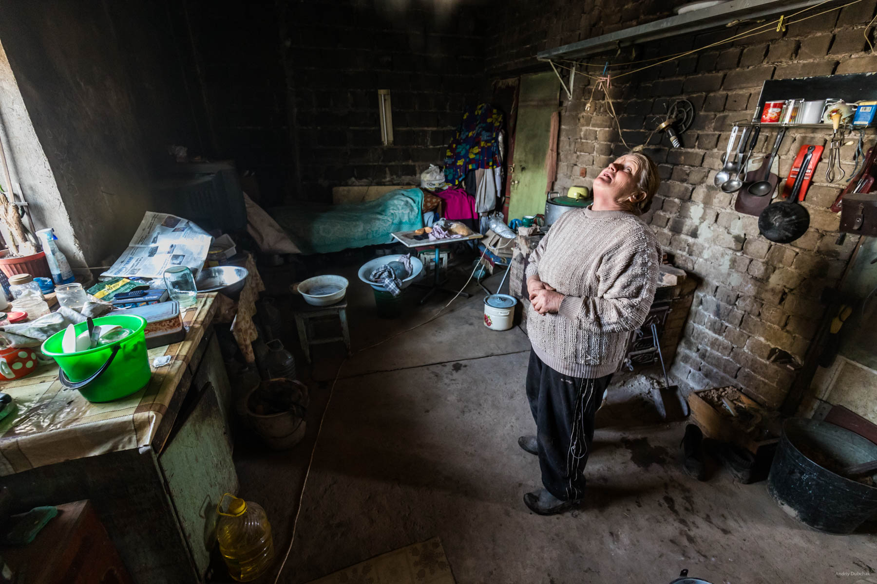 """In Vodyane, Spring of 2018, seven families were permanently residing (10 people). They farmed the land, raised livestock - goats (milk that they sold or changed for food from soldiers), pigs and poultry. Only a small amount of assistance was received from international humanitarian organizations. There was no separate assistance from the Ukrainian state.  One of them is baba """"Zoya"""" (military called the woman that way). The husband and son of the woman died, she lived alone. After the fighting began, other her relatives - daughter - and the four grandchildren left for Russia. Marine_22.jpg"""