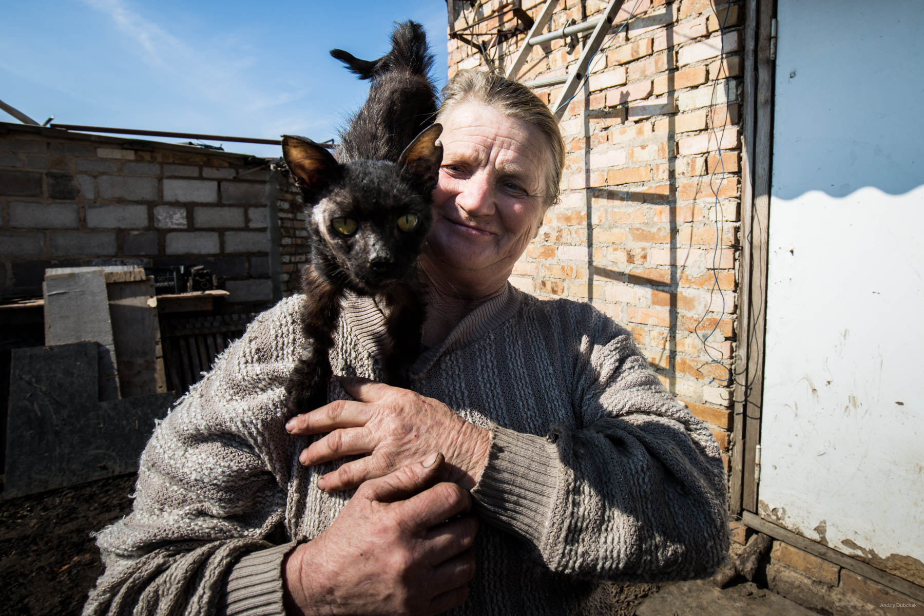 """""""Hello from Vodyane"""". Baba Zoe with her cat Timka. The cat was wounded and ill, the woman nursed it, as she could. Vodyane, March 2018."""