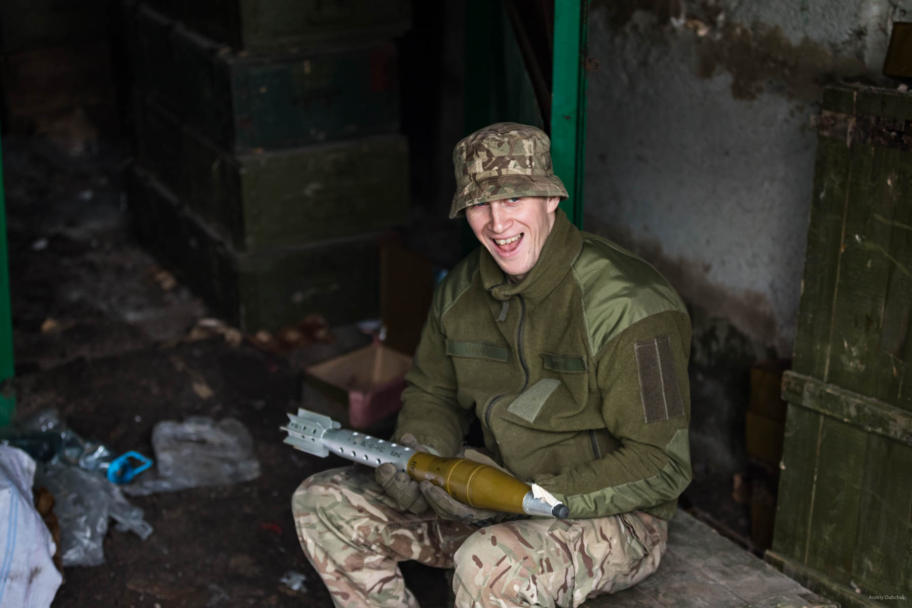 """A warrior of the marines, Andrew, with a """"gift"""" for militants on the front, near Mariupol. In his hands - a charge for a """"boot"""", (SPG - tripod-mounted man-portable antitank gun). This can hit both armor and fortifications (depending on the warhead). Maximum range is 4500 m, the point-blank range is 800 m, the target range is 1300 m. Vodyane, March 2018."""