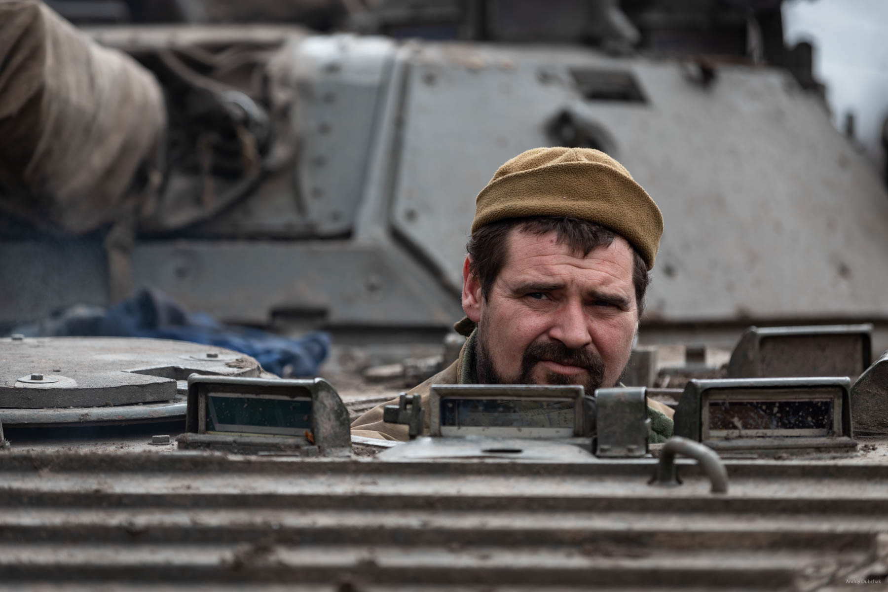 """A company's technician with a call name """"YU"""" on BMP-2 during delivery of """"BC""""(ammunition load) and food to the front. Vodyane, March 2018."""