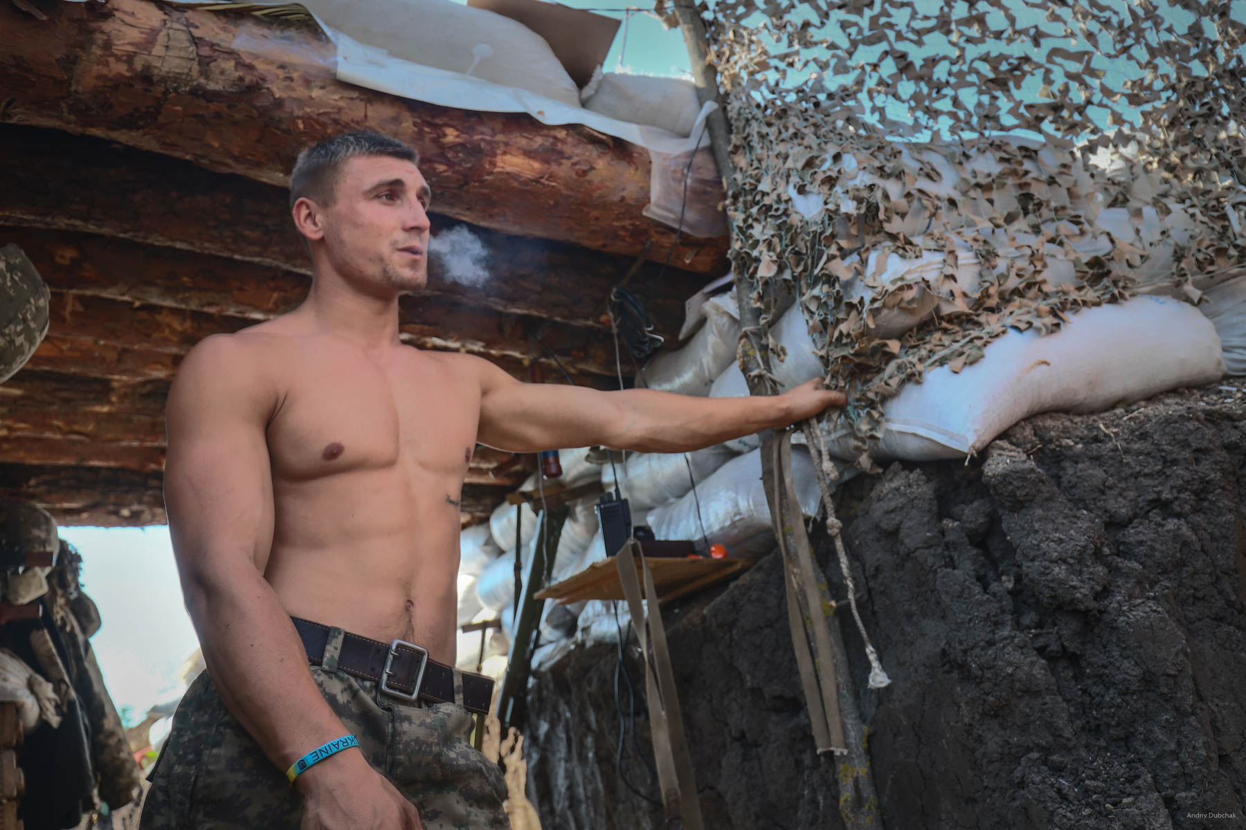"""A sailor of Marines with a call name """"Rambo,"""" during a snack at the front, near Vodyane. The heat in June was terrible. Vodyane, March 2018"""