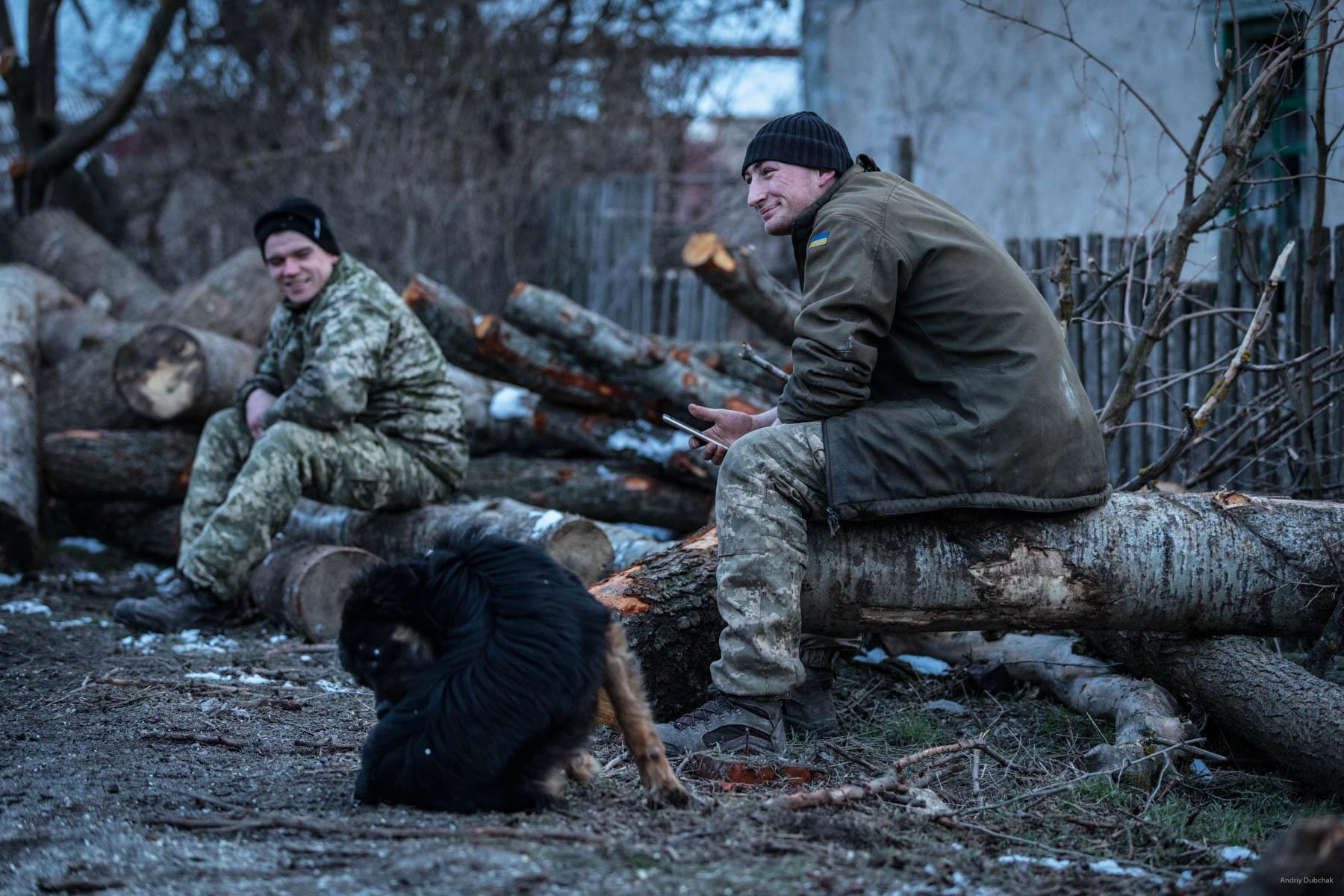 Driver, Vasily, and sailor, Dmitry, rest after harvesting firewood. Shirokine, March 2018.