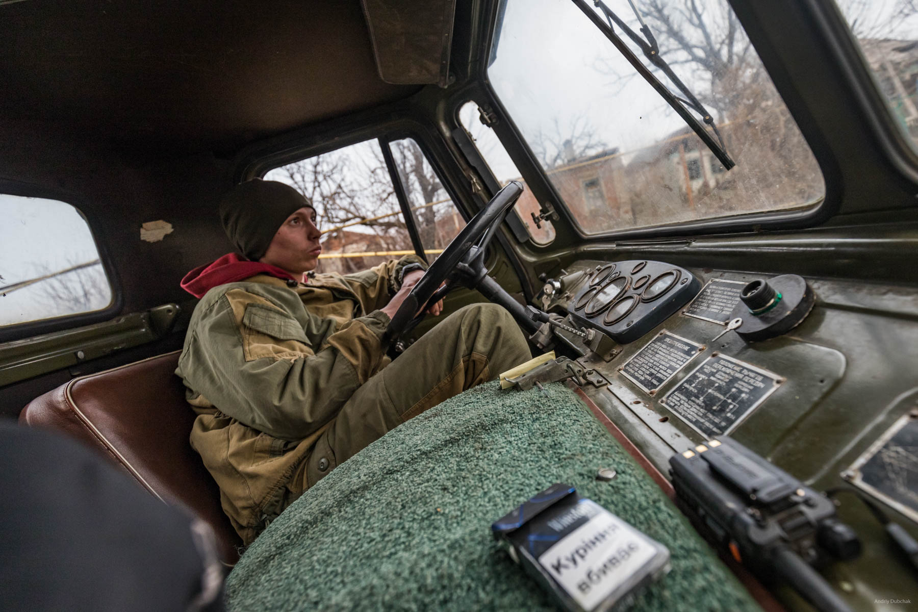 """On his """"Shishiha,""""Driver, Vitaliy, (23 years old, native of Cherkassy region) delivered firewood to one of the front positions. In Shirokine, it was his second rotation. The front driver is a dangerous military profession, since transport is one of the main targets of gunfire, and the enemy shoots through the entrances to the front positions from all types of weapons. The main advice from Vitaly was - never panic! Shirokine, March 2018."""