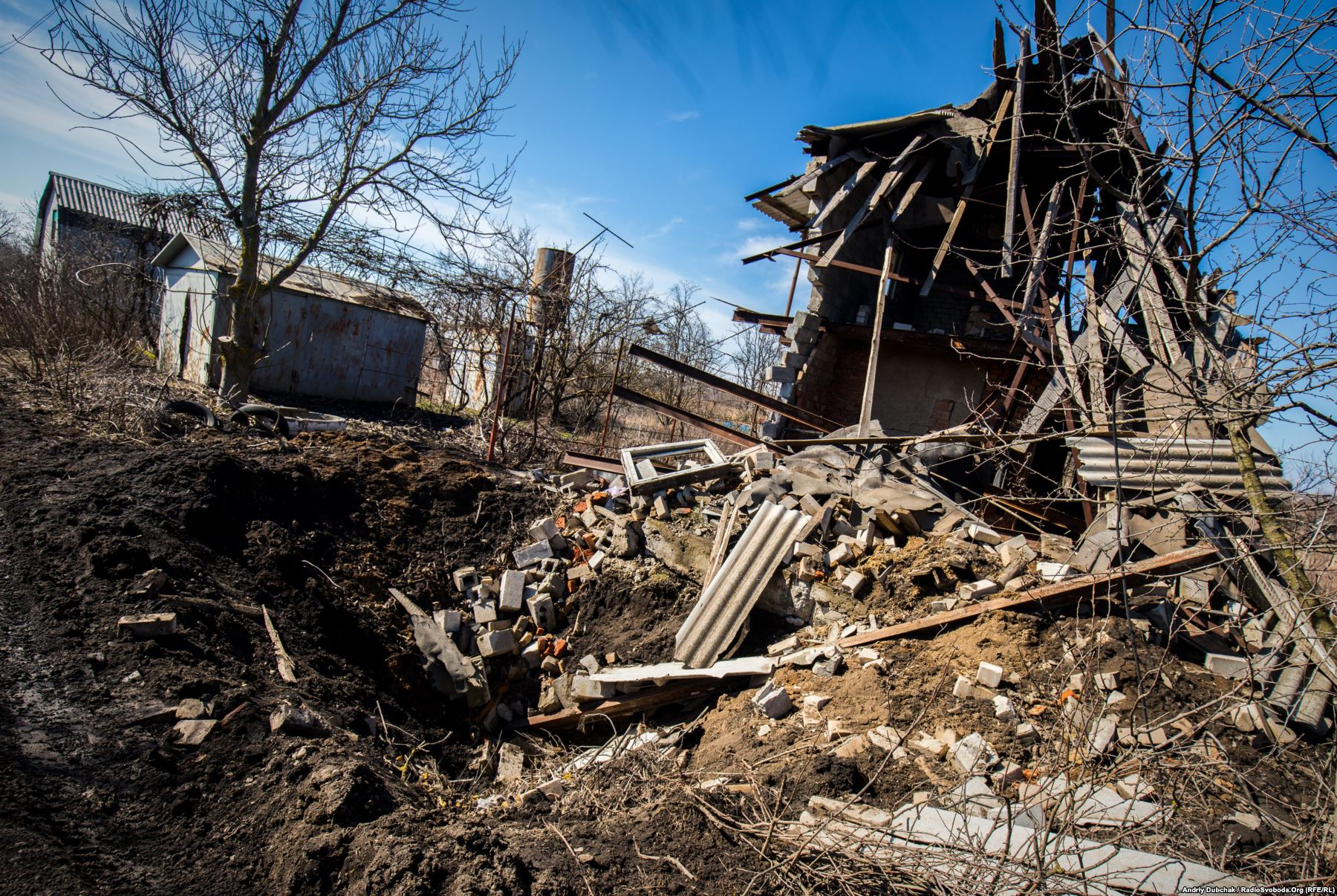 """Destruction caused by an """"incoming"""", probably a 152-millimeter projectile, in a house, Vodiane village, March 2018."""