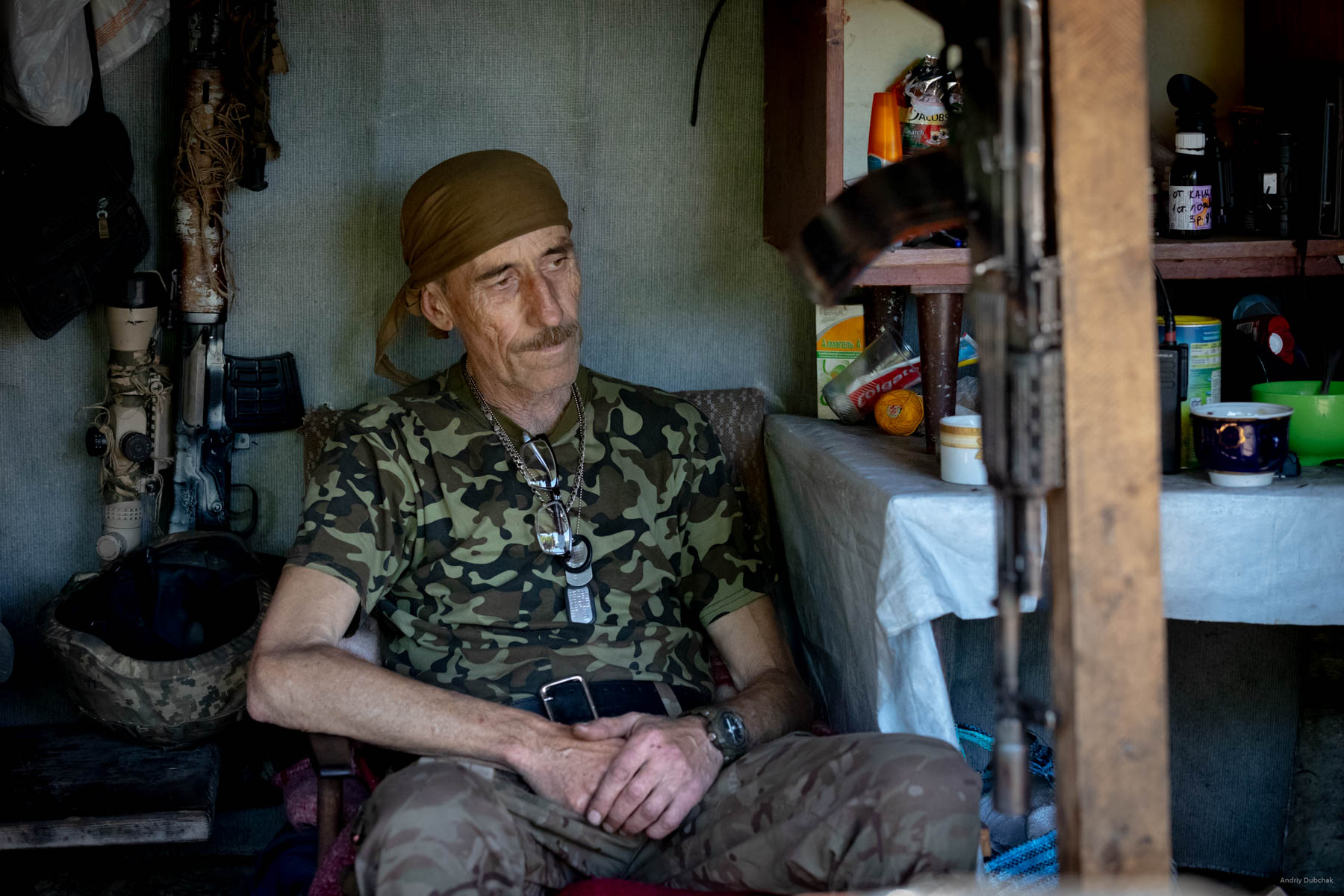 """We visit one of the military positions. Soldiers treat us to coffee. Mainly middle-aged warriors held these defensive positions. In the photo is a warrior soldier named """"Mamay."""" He is in the war since March 2014. The man is 59 years old.  He performed many functions: physician, field engineer, cook, fighter. Settlement Pivdenne, near Gorlivka on June, 17th, 2018"""