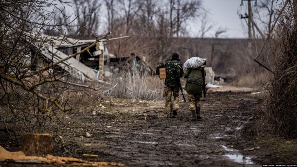 Ukrainian marines carry potatoes and other food toward a frontline position. Photo by Andriy Dubchak