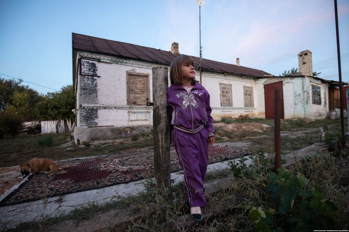 For protection against shrapnel, the windows of Sabrina's home in Pavlopil have been covered with bricks. (photo: Andriy Dubchak)