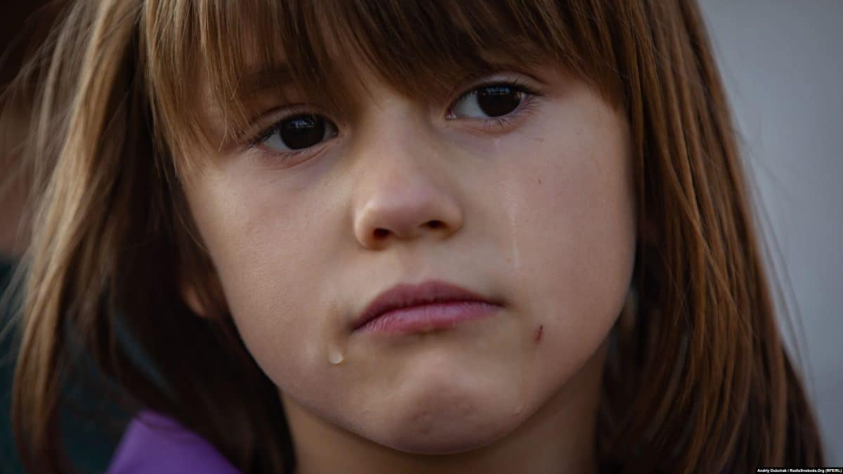 Sabrina cries as her mother describes the war's effects on life in Pavlopil. *(photo: Andriy Dubchak)