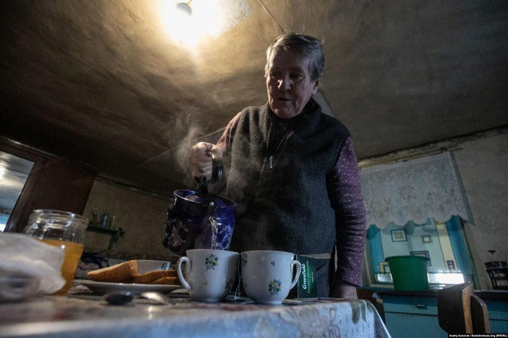 """A resident of Katerynivka, Grannie Liuba, tells us what's happening in the village. It's been very quiet for a few days; nobody is shooting. She is """"for disengagement""""; she wants """"the shooting to stop"""". But, she doesn't want to live in the """"grey zone"""", and adds that if the authorities had offered to help her leave, she would have gone (photographer Andriy Dubchak)"""